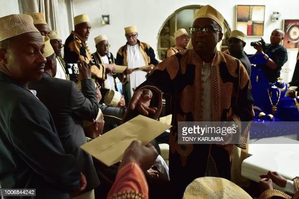 Kin an representatives of the groom and his family pass enevelopes containing monetary offerings before they can be allowed to see the bride at the...