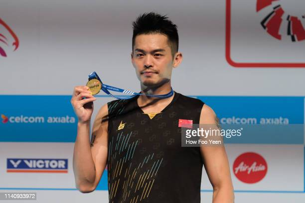 Kin Dan of China poses with his medal on day six of the Badminton Malaysia Open at Axiata Arena on April 07 2019 in Kuala Lumpur Malaysia