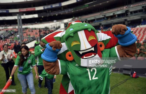 Kin the official mascot of the Mexican national football team cheers before the start of the 2018 World Cup Concacaf qualifier football match between...