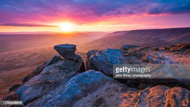 kinder scout mountain, fairbrook naze on with golden light at sunrise. peak district. uk - peak district national park stock pictures, royalty-free photos & images