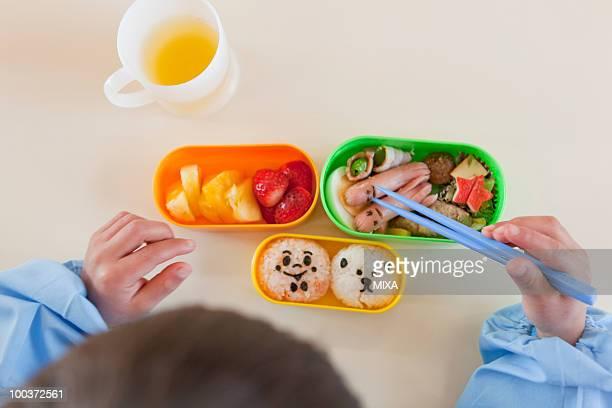 Kindergarten Boy Having Lunch