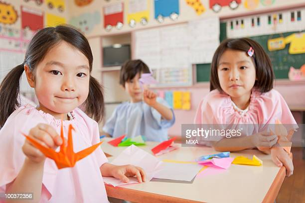 Kindergarten Children Holding Paper Crane