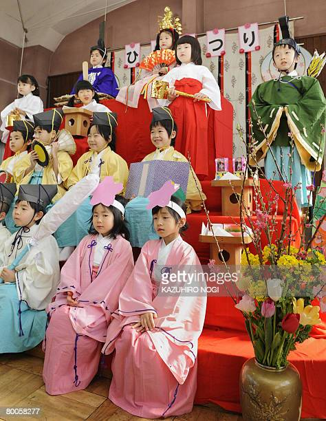 Kindergarten children in traditional costumes pose on a platform for hinamatsuri or doll festival at Tokyo's Mukojima Bunka kindargarten February 29...
