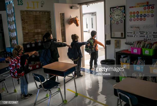Kindergarten class socially distances while preparing to leave their classroom at Stark Elementary School on October 21, 2020 in Stamford,...