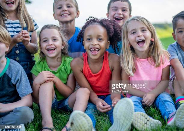 kindergarten kids in a park - field trip stock pictures, royalty-free photos & images