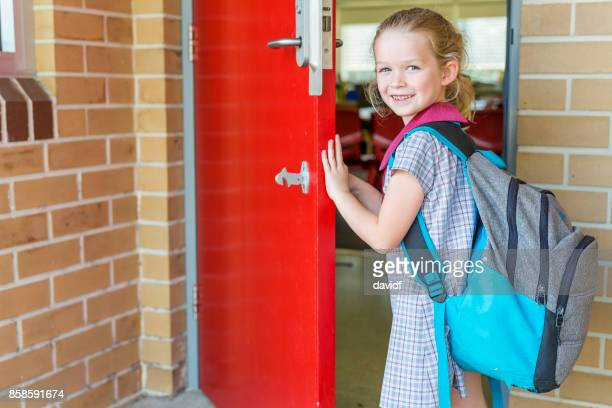 kindergarten primary school girl student arriving for class - arrival stock pictures, royalty-free photos & images