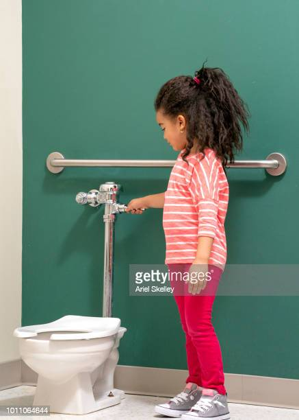 Little Girl Pee Photos and Premium High Res Pictures