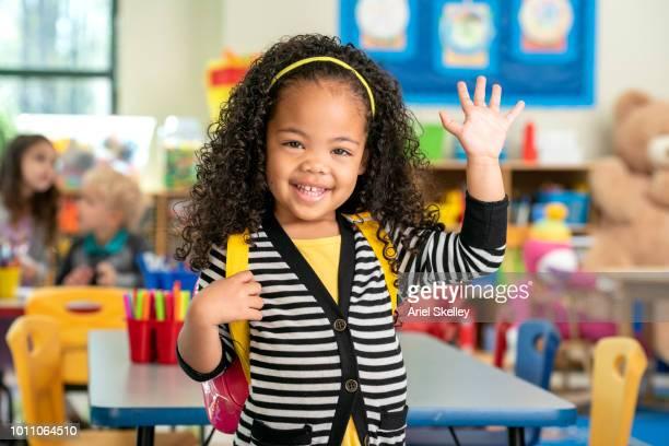 kindergarten student in classroom - first occurrence ストックフォトと画像