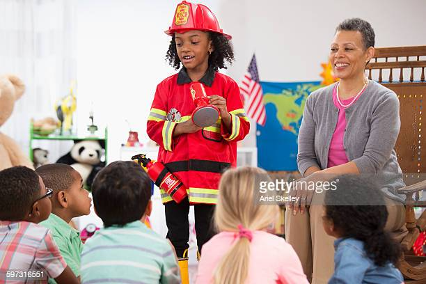 Kindergarten student wearing fire fighter costume