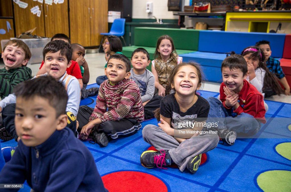 Kindergarten students at Guilford Elementary school, sing ...