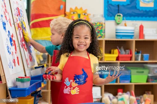 Kindergarten Students Finger Painting