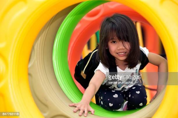 Kindergarten students play in the international kindergarten playground.