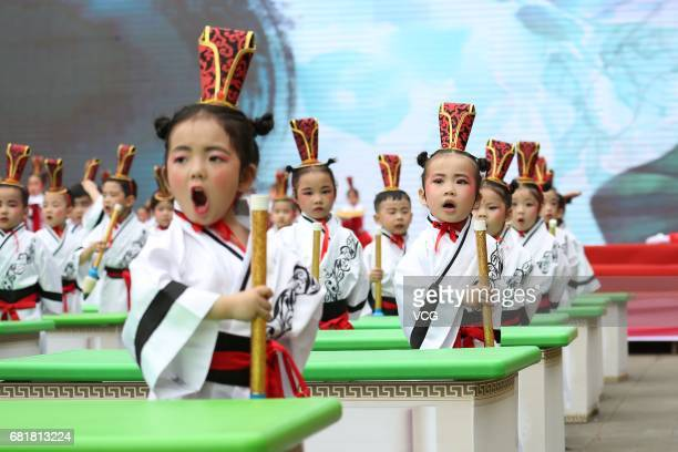 Kindergarten students write Chinese calligraphy during a Chinese traditional culture performance at Wusheng County on May 10 2017 in Guang'an Sichuan...