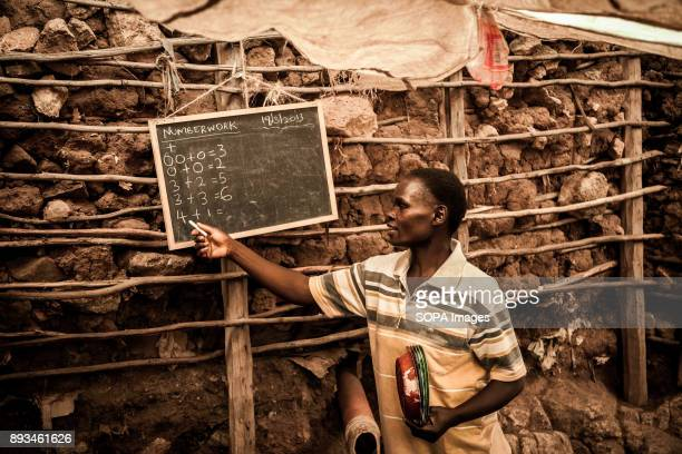 Kindergarten teacher during math class Ngota's Upendo Primary School is a small school located in the heart of Mathare Slum Kenya's second biggest...