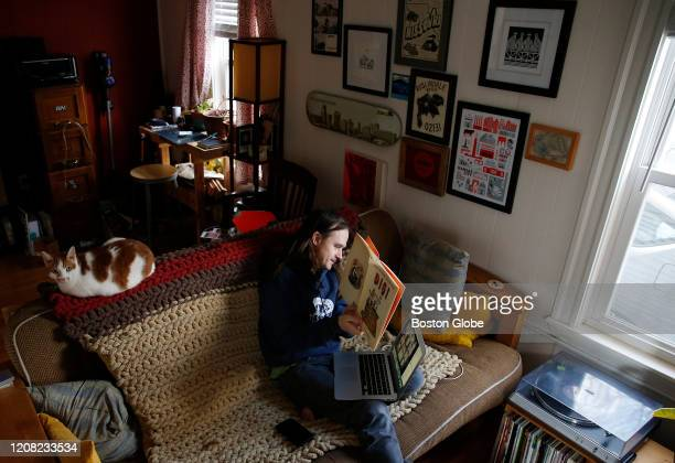 Kindergarten teacher Jamie Baldwin reads a children's book to his students as he conducts a Zoom video lesson from his living room in Roslindale MA...