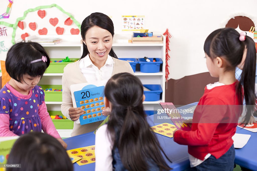 Kindergarten Teacher Teaching Children Maths Stock Photo | Getty Images