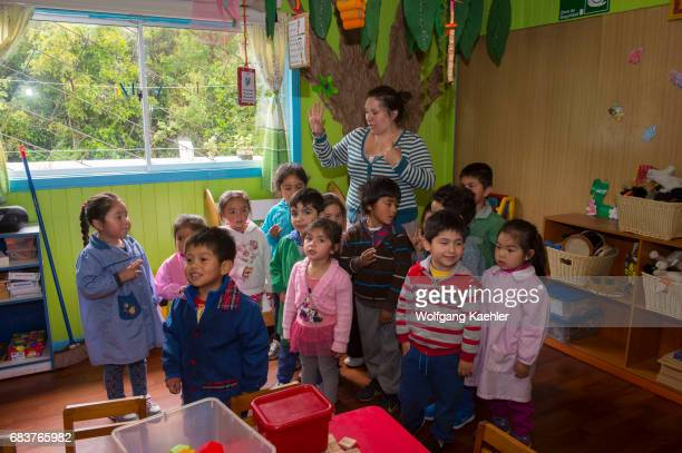 A kindergarten teacher with students in the village of Pargua in the Lake District of Chile