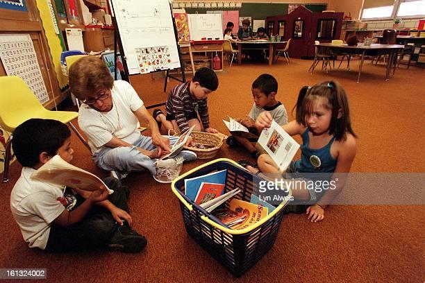 Kindergarteners at Cheltenham Elementary School read with their substitute teacher Margie Montoya Johns The school has some half day kindergarten...
