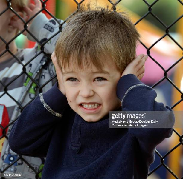 Kindergartner Quinton Raven covers his ears while hearing a siren from a Longmont fire truck at Longmont Estates Elementary Wednesday morning Oct 09...