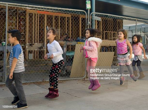 Kindergartners at Jack Weaver Elementary hop past construction on their way back to their classroom after recess The Los Alamitos school has been in...