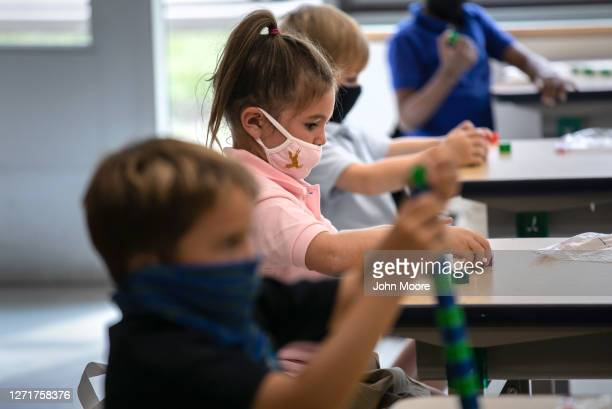 Kindergartners, including Harper Shea , play with blocks on their first day of class on September 9, 2020 in Stamford, Connecticut. For millions of...