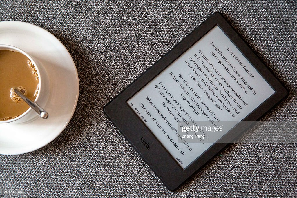 kindle on a sofa amazon released a new entry level kindle in the