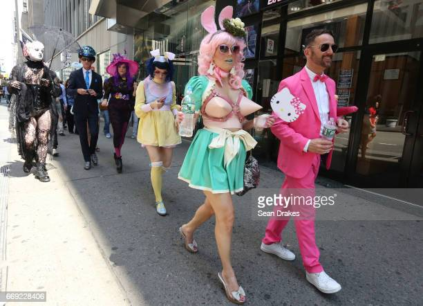 Kindra Meyer and Danny Putnam with friends walk on 6th Avenue toward Times Square after the Easter Parade on April 16 2017 in New York City USA