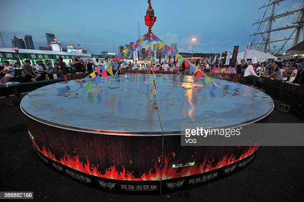24 kinds of seafood are cooked in a large cauldron during the 8th Qingdao International Sailing Week Qingdao International Marine Festival on August...
