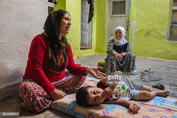 Kine Demir sits in her home in Diyarbakir with her son and motherinlaw Forced to leave their villages many families relocated to the cities But with...