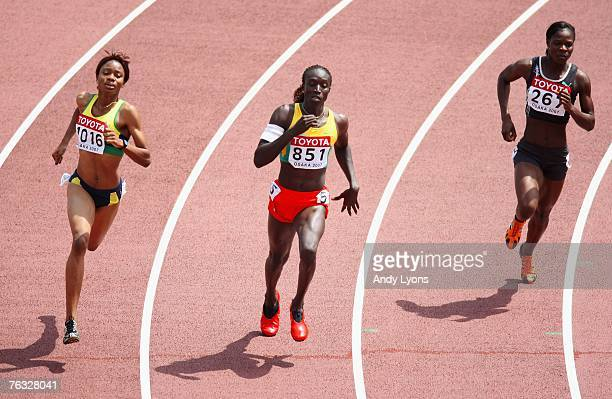Kineke Alexander of St Vincent, Amy Mbacke Thiam of Senegal and Amantle Montsho of Botswana compete during the Women's 400m heats on day two of the...