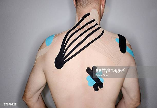 kinesiology tape on man's back