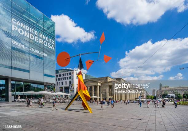 """kinetic sculpture titled """"crinkly with red disk"""" by american sculptor alexander calder at the contemporary and modern art museum schloßplatz stuttgart, baden-württemberg, germany, july 7, 2016 - castle square stock pictures, royalty-free photos & images"""