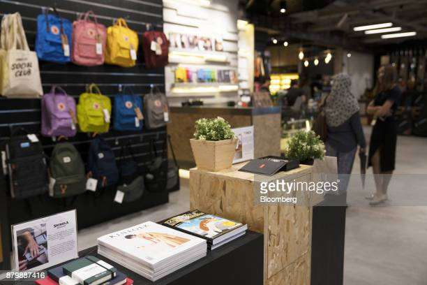 Kinfolk and Monocle magazines sit on display with other merchandise at the Swee Lee Holdings Pte Star Vista Lifestyle Store in Singapore on Wednesday...