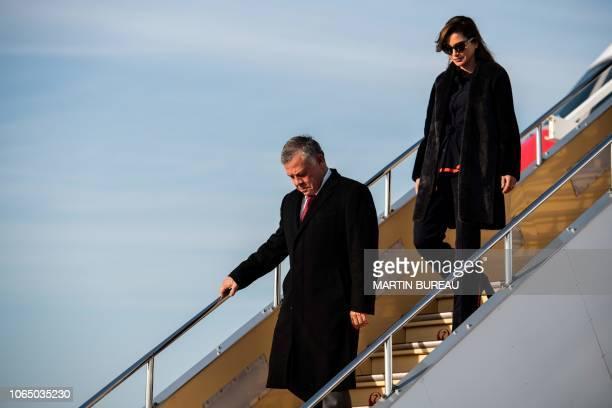 King Abdallah II of Jordan and his wife Queen Rania alYassin arrive at Haneda airport in Tokyo on November 25 2018