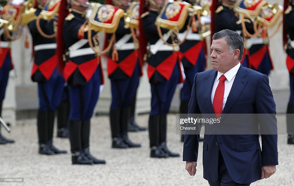 King Abdallah II of Jordan walks past Republican Guards as he arrives before his meeting with French President Francois Hollande at the Elysee Presidential Palace on September 17, 2014, in Paris, France.