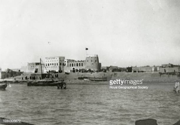 King Abdul Aziz Ibn Saud's port and fortified government buildings at Qatif on the east coast of Arabia too shallow to be visited by ocean going...