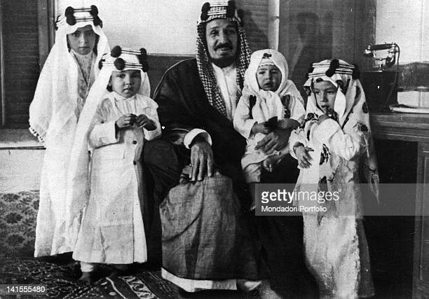 King AbdulAziz ibn Saud of Saudi Arabia posing with his four children after having being attacked Saudi Arabia 15th March 1935
