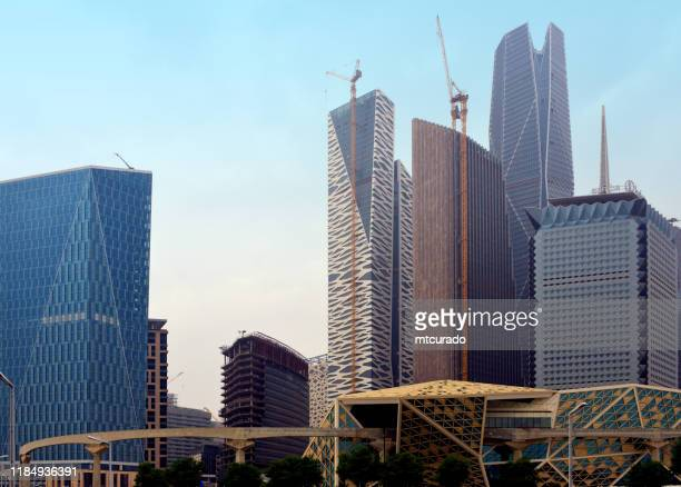 king abdullah financial district (kadf) skyscrapers and monorail, al aqeeq, riyadh, saudi arabia - financial district stock pictures, royalty-free photos & images