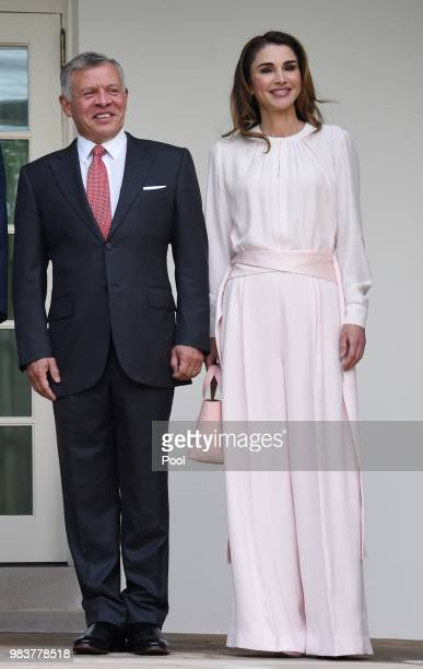 King Abdullah II and Queen Rania of Jordan on their arrival at the South Portico of the White House on June 25 2018 in Washington DC