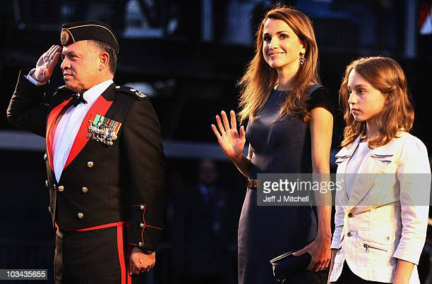 King Abdullah II bin alHussein and Queen Rania and Princess Iman of Jordan attend the Royal Military Tattoo at Edinburgh Castle on August 18 2010 in...