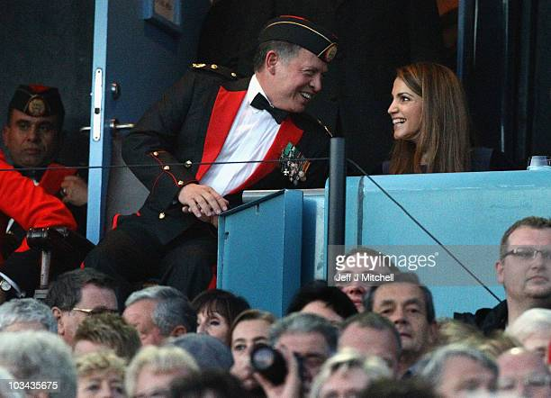 King Abdullah II bin alHussein and Queen Rania of Jordan attend the Royal Military Tattoo at Edinburgh Castle on August 18 2010 in Edinburgh Scotland...