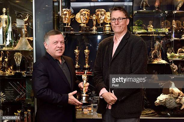 King Abdullah II ibn Al Hussein of Jordan and Sir Richard Taylor pose with one of Sir Richard's Academy Awards during a visit to Weta Workshops on...