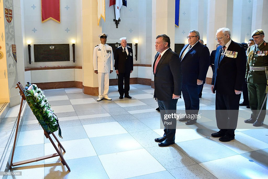 King Abdullah II Ibn Al Hussein (Front) of Jordan pays his respects with Rear admiral David Ledson retired (Back R) and Hon Gerry Brownlee (Back L) minister of transport during a wreath laying ceremony at the National War Memorial on November 28, 2016 in Wellington, New Zealand. King Abdullah II ibn Al Hussein of Jordan is in New Zealand for a 4 day visit.