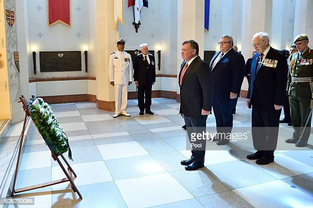 King Abdullah II Ibn Al Hussein of Jordan pays his respects with Rear admiral David Ledson retired and Hon Gerry Brownlee minister of transport...