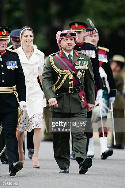 King Abdullah II of Jordan accompanied by his wife Queen Rania of Jordan attend a Passing Out Parade at Sandhurst Military Academy on August 11 2006...