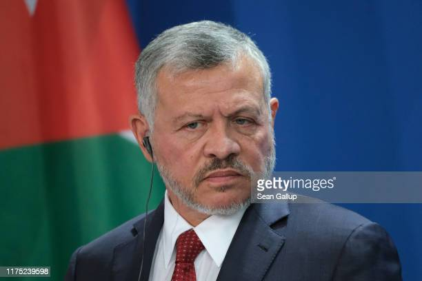 King Abdullah II of Jordan and German Chancellor Angela Merkel speak to the media following talks between the two leaders at the Chancellery on...