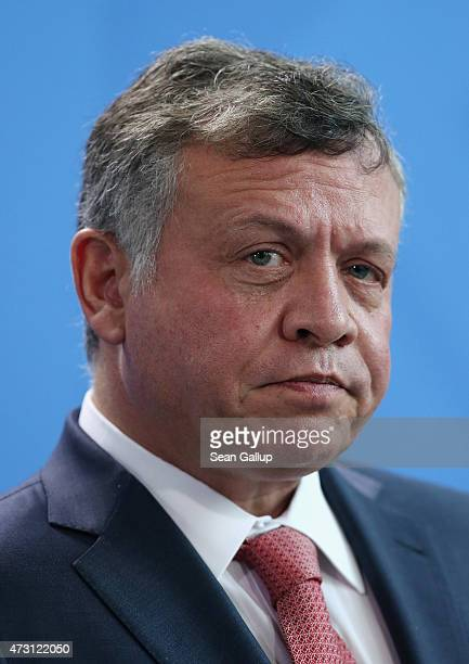 King Abdullah II of Jordan and German Chancellor Angela Merkel speak to the media following talks at the Chancellery on May 13 2015 in Berlin Germany...