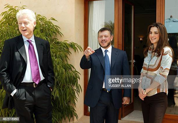 King Abdullah II of Jordan and his wife Queen Rania pose with former US President Bill Clinton at their palace in Aqaba 350 kms south of Amman 19 May...