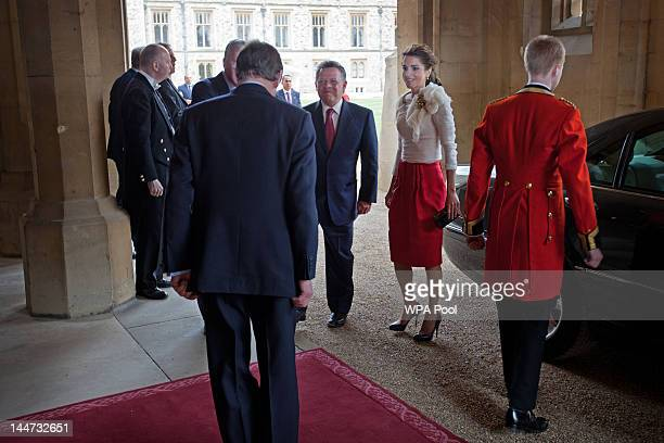 King Abdullah II of Jordan and Queen Rania of Jordan arrive at a lunch For Sovereign Monarchs in honour of Queen Elizabeth II's Diamond Jubilee at...