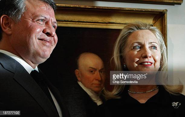 King Abdullah II of Jordan and US Secretary of State Hillary Clinton pose at the State Department January 18 2012 in Washington DC Abdullah met with...